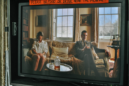 shot of camera screen with two actors sitting on a sofa
