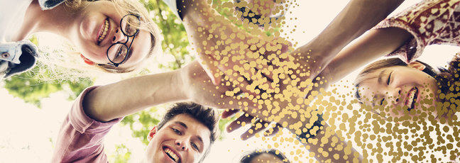 Group of adolescents with their hands together
