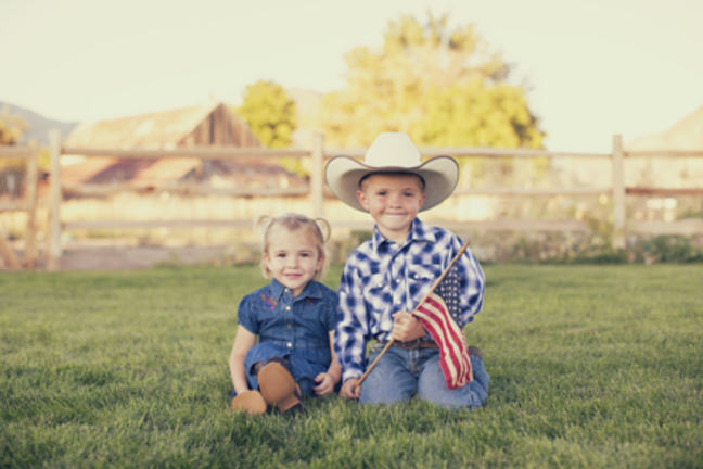brother sister with American flag