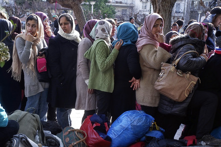 Migrants, mostly from Afghanistan, wait to receive food delivered by a humanitarian organisation.
