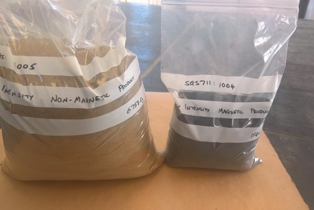 2 bags of monazite concetrate, which look like bags of sand.