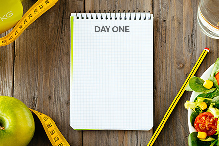 A blank food diary on a kitchen counter.