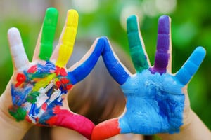 Image showing a child's hands, covered in paint