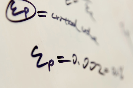 Detail of a mathematical formula on a whiteboard.