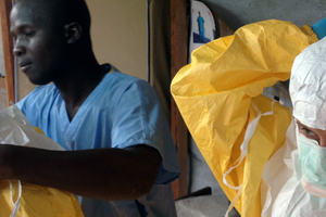 Ebola virus outbreak - response staff wearing protective equipment