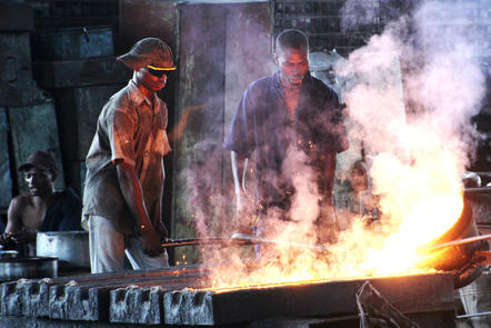 Workers at a smelting plant in Tanzania. Photo: Gro Tjalvin