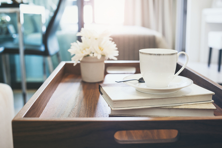 A coffee-table with a mug and books.