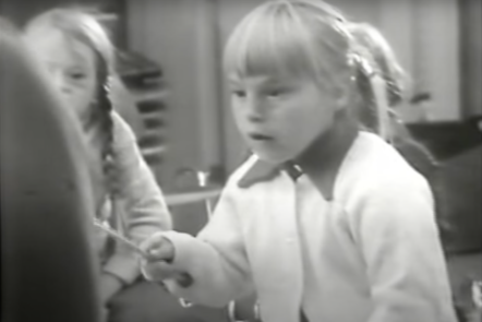 A screenshot from the archive video of Karin during a music therapy session
