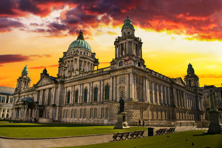 A picture of Belfast City Hall at sunset.