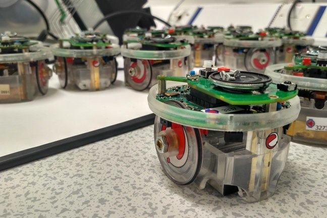 Our team of puck-like, 'e-puck' robots