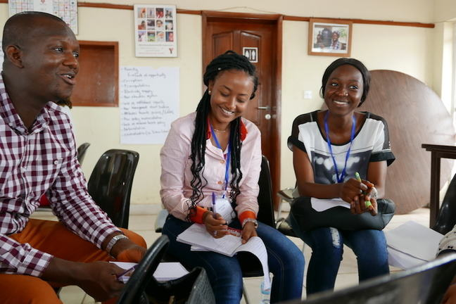 Image shows three learners in a classroom scenario.