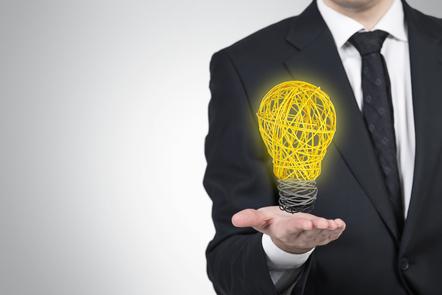 Business man holding a light bulb