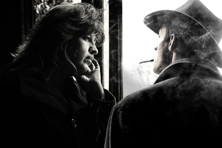 An atmospheric black and white picture of a man wearing a panama hat and smoking, talking to a woman.