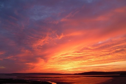 An incredible sunset with shades of red, orange and yellow spread over the horizon.