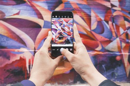 A wall of graffiti viewed through a camera phone