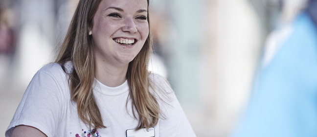Lady in a CRUK T-shirt smiling