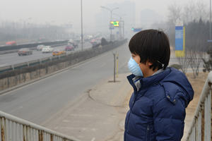 Boy Wearing Mouth Mask Against Air Pollution