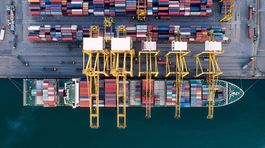 Containers craned onto ship at docks