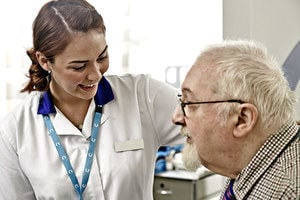 A patient and a nurse interacting