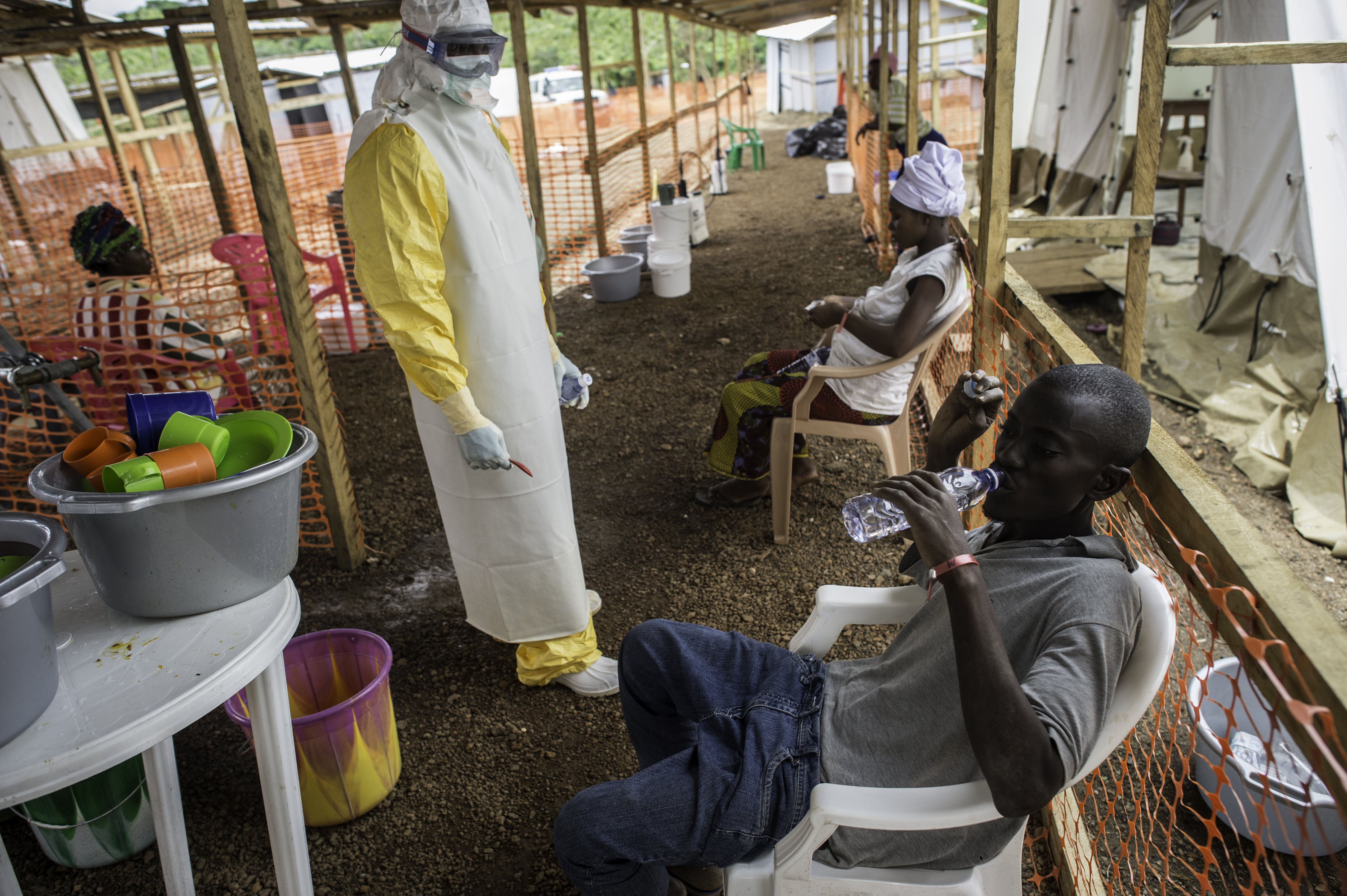 Patient rehydrating himself in an Ebola Treatment Unit