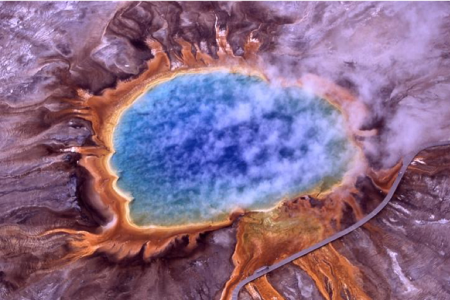 Extremophilic Algae turn the edges of this volcanic hot spring orange. Grand Prismatic Spring, Yellowstone National Park.