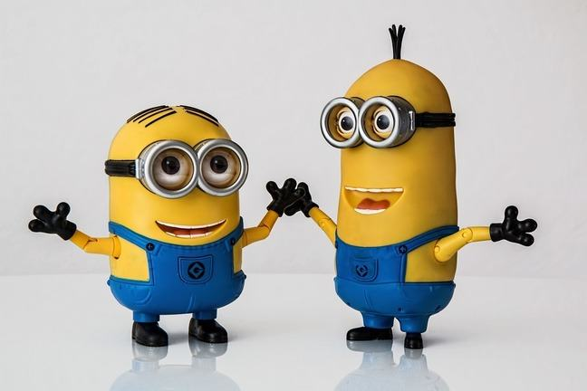 Two minion toys dancing