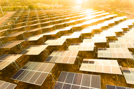 A large PV plant with the sun rising