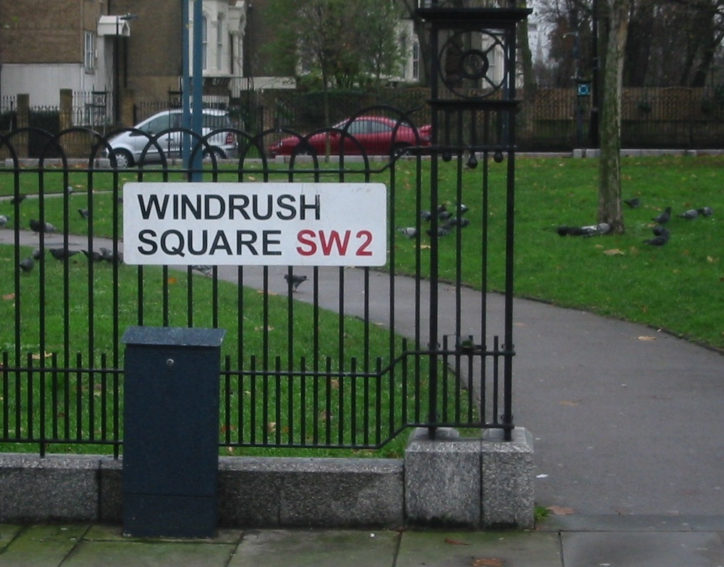A close up of Windrush Square roadsign in Brixton, London
