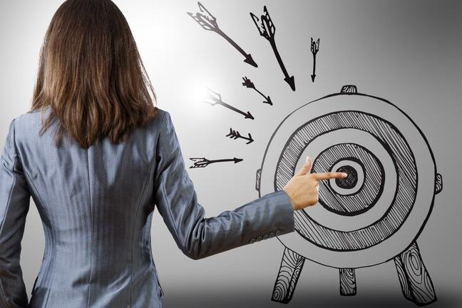 women pointing finger at the bullseye of an illustrated target
