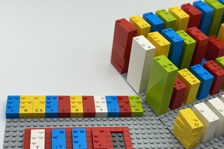 Image of alphabetical towers of LEGO Braille Bricks