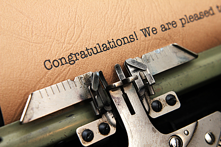 The word congratulations written by a type writter
