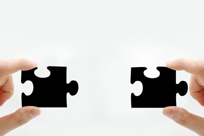 The same piece of a jigsaw held in the left and right hands