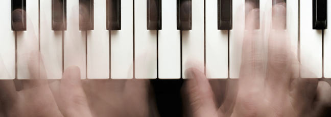 A pair of hands on a keyboard, playing jazz piano