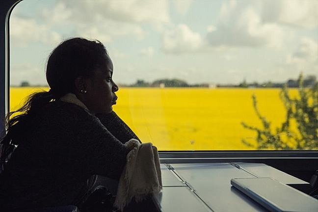 Lady on train looking out of window