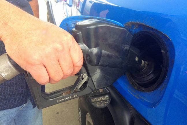 Hand pumping gasoline