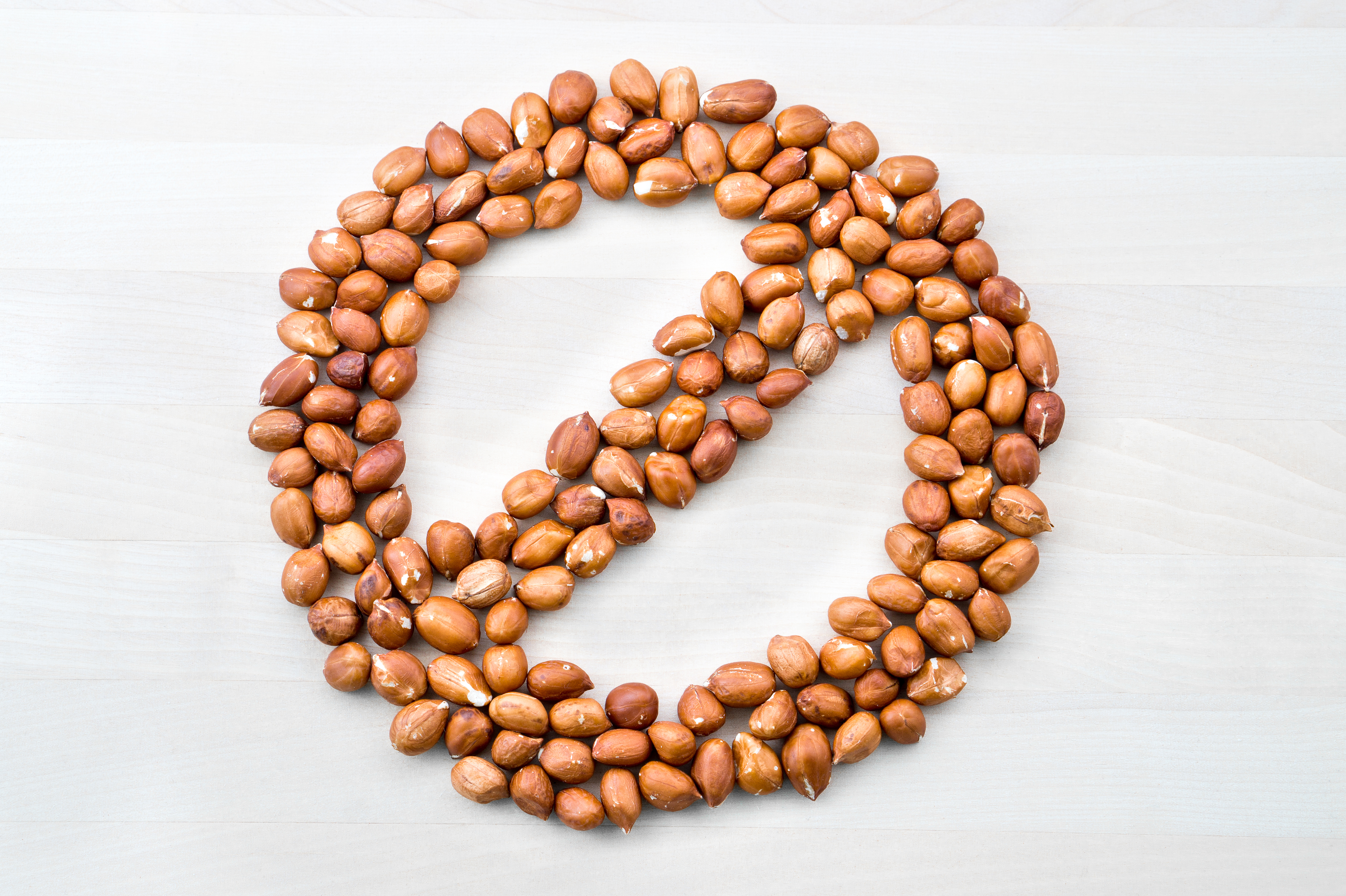 Nuts arranged in a stop sign image