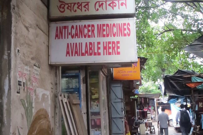 This was an ad for anti-cancer medicine outside a pharmacy in Kolkata, India, 2012