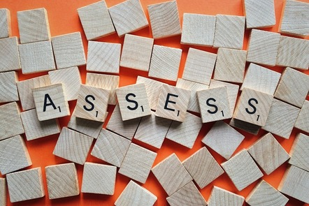 scrabble pieces spelling out the word 'assess'