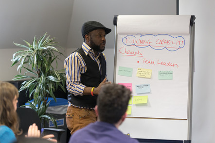 man presenting idea on a flip chart