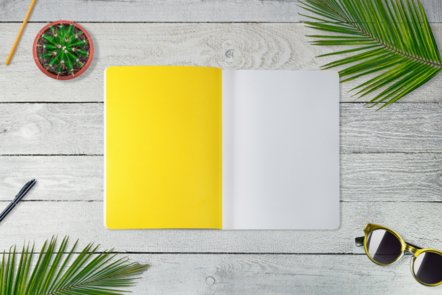 yellow notebook open on desk