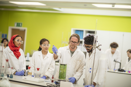 Four people in a laboratory