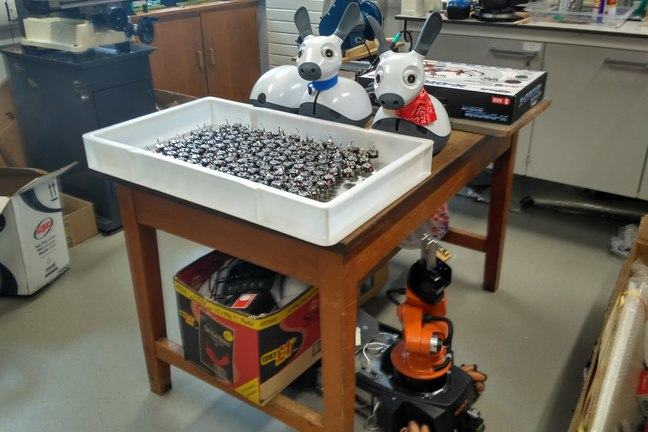 Different types of robots all packed away in a workshop