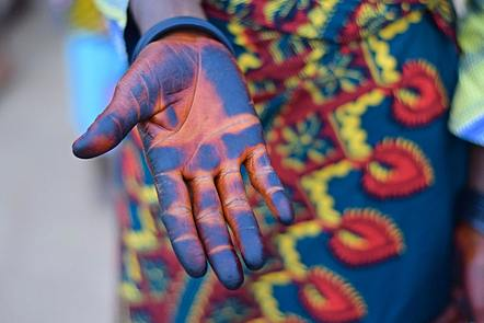 African woman's hand with blue colouring.