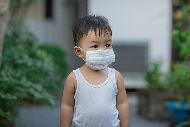 Young boy wearing a face mask