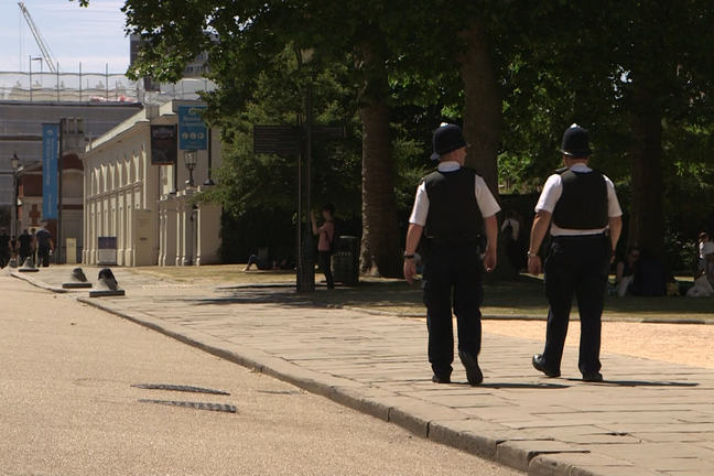 Police officers patrol on the streets of London