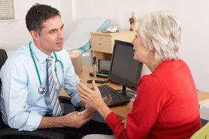 Image showing a GP and patient in conversation