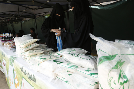 Women, in the war-ravaged country, show their healthy-mixed flour for sale.