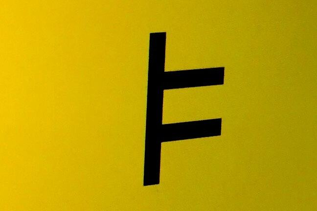 The 'entails' symbol: a vertical line with two parallel horizontal lines attached at mid-height on its right-hand side