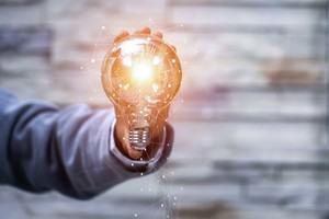 Business man holding light bulbs, ideas of new ideas
