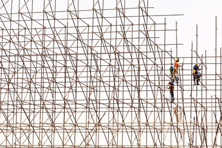 Image: https://pixabay.com/en/scaffolding-workers-construction-1617969/  CC0 Five scaffolders completing the erection of a scaffolding. Scaffolding poles with the five scaffolders on the right of the image, in a set of two and a set of three